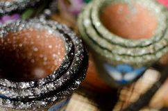 Stacks of small Mexican ceramic decorative pots with black and g Stock Photos