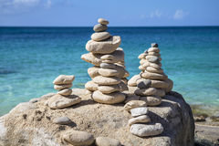 Stacks of stones in balance at a beach Stock Photography