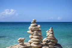 Stacks of stones in balance at a beach Stock Images