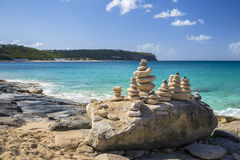 Stacks of stones in balance at a beach Royalty Free Stock Photography