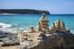 Stacks of stones in balance at a beach Royalty Free Stock Images