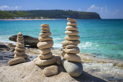 Stacks of stones in balance at a beach Stock Photo