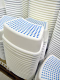 Stacks of stools. Stacks of white stools in retail store Royalty Free Stock Photography