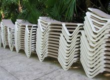 Stacks of sun loungers. At tropical resort royalty free stock images
