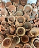Stacks of terracotta plant pots Royalty Free Stock Images