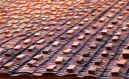 Stacks on the tiled roof Royalty Free Stock Photography