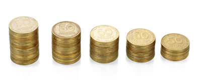 Stacks of Ukrainian coins face value 50 isolated on white. Royalty Free Stock Photos