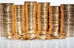 Stacks of US dollar gold coins. With native american sacagawea's image Stock Images