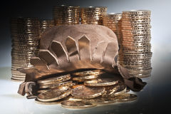 Stacks of  US dollar gold coins. Stacks of  dollar gold coins with native american sacajawea's image pouring from leather pouch Royalty Free Stock Image