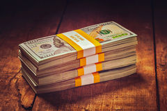 Stacks of 100 US dollars 2013 edition banknotes Stock Photography