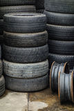 Stacks of used tires. There are stacks of old used car tires waiting to be reused stock image