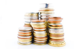 Stacks of various coins Stock Image