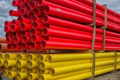 Stacks of various colored pvc water pipes Stock Images