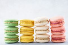 Stacks of various colorful macarons in a row. Creative design stock photo