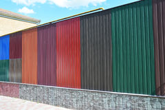 Stacks of various colorful metal fence panels and metal roof sheets for sale. Building and construction materials, colored steel Royalty Free Stock Image