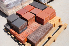 Stacks of various and for sale. Building and construction materials, colored concrete pavers (paving stone) or patio blocks organ royalty free stock image