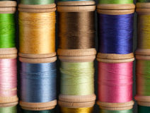 Stacks of Vintage Threads on Wooden Spools Stock Photography