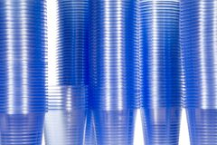 Plastic water cups for a vending machine. Stacks of water cups with blue colour, towers of cups Stock Image