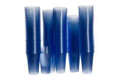 Plastic water cups for a water machine. Stacks of water cups with blue colour, towers of cups Stock Photo