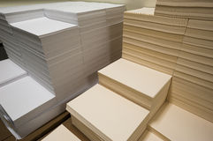 Stacks of white and beige paper. In a modern print shop Stock Image