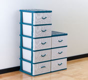 Stacks of white and blue plastic drawers Stock Image