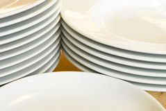 Stacks of white dinner plates Royalty Free Stock Image