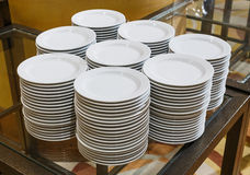 Stacks of white dishes Stock Images
