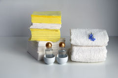Stacks of white loop towels,cosmetic products, cotton pads, paper tissues, paper napkins, toilet paper Stock Photos