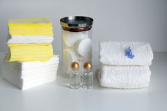 Stacks of white loop towels,cosmetic products, cotton pads, paper tissues, paper napkins, toilet paper Stock Photo