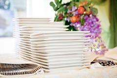 Stacks of white plates Royalty Free Stock Photo