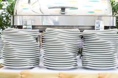 Stacks of white plates Royalty Free Stock Image