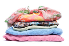Stacks of women colored clothes. On white background Royalty Free Stock Images