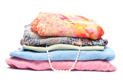 Stacks of women colored clothes. On white background Royalty Free Stock Photos