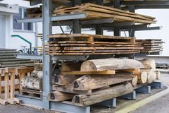 Wood piled up in the plant. Stacks of wood piled up in wood factory royalty free stock photo