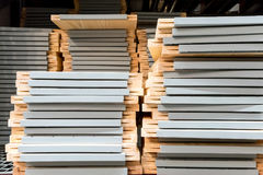 Stacks of wooden furniture on steel racks Royalty Free Stock Images