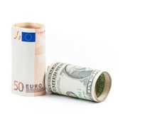 Stacza się w górę euro i stacza się w górę dolara banknotu na białym tle, pojęcie dla biznesowego i save pieniądze Obrazy Stock