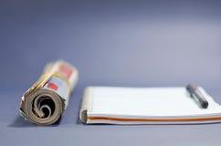 Staczający się notatnik i magazyn obrazy royalty free