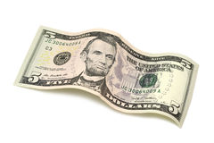 Staczający się rachunek pięć dolarów Zdjęcia Royalty Free