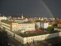 stad över regnbågen Arkivbild