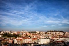 Stad av Lissabon på solnedgången Arkivfoto