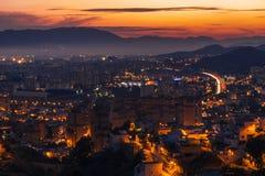 Stad av Malaga på skymning Arkivbild