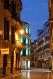 Stad av Malaga på natten, Spanien Arkivfoto