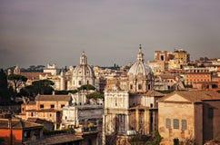 Stad av Rome på skymning Arkivfoton