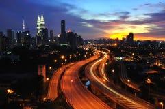 Stad bij zonsondergang Stock Afbeelding