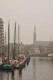 Stad in de mist Stock Foto