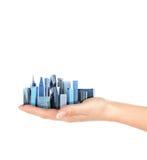 Stad in de palm van een mens Stock Fotografie