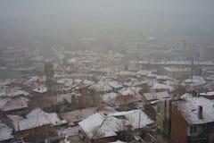 Stad en sneeuwval stock afbeelding