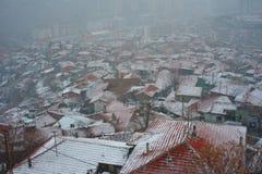 Stad en sneeuwval stock foto's