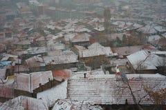 Stad en sneeuwval royalty-vrije stock foto