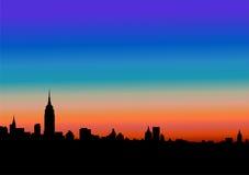 Stad på solnedgången Royaltyfria Bilder